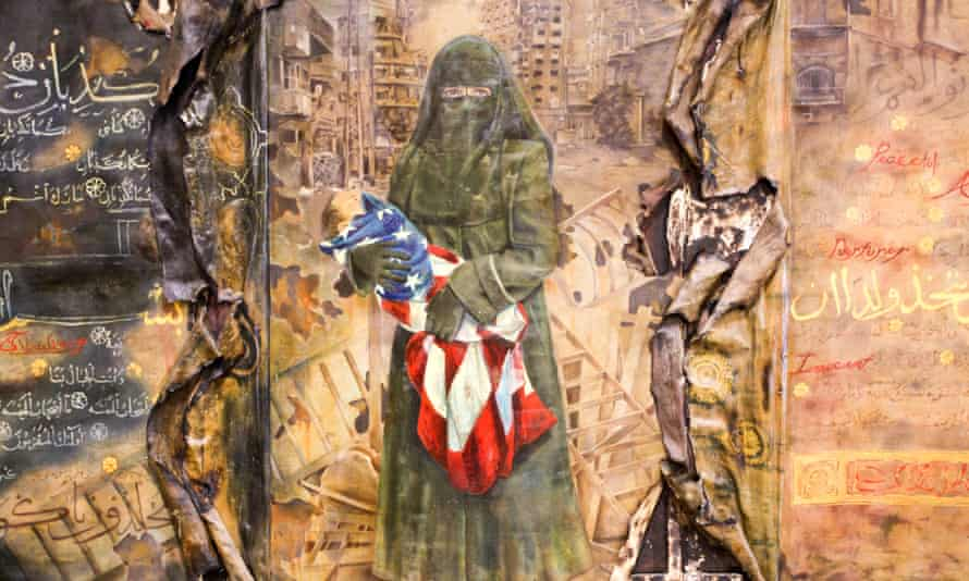 Another image shows a woman in a niqab cradling a baby wrapped in the American flag.