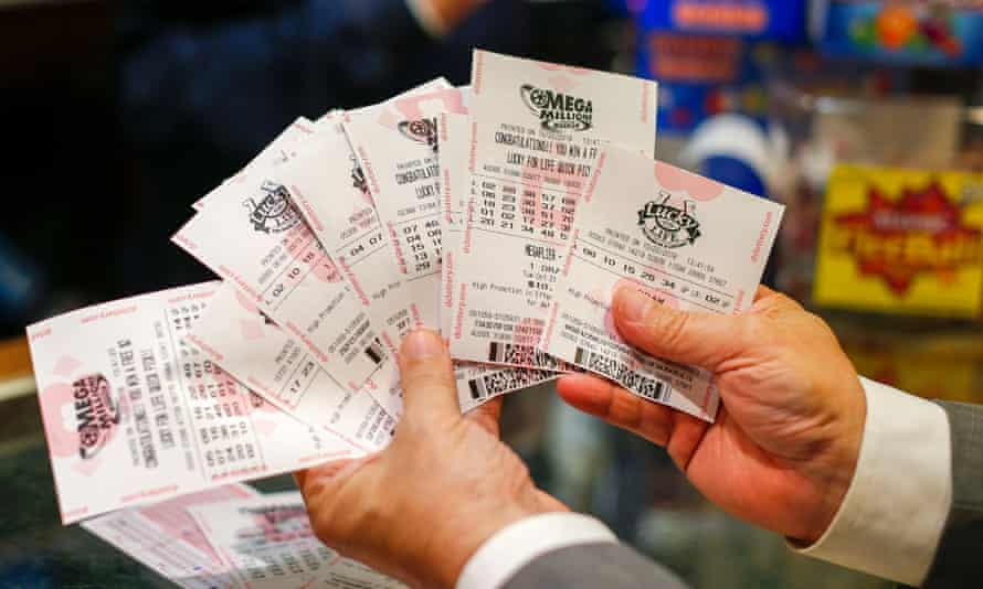 A customer purchases Mega Millions lottery tickets at a retailer in Washington DC.
