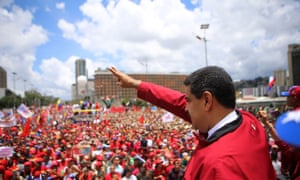President Nicolás Maduro waves to supporters during a rally in Caracas on Thursday, in this image released by the presidential press office.