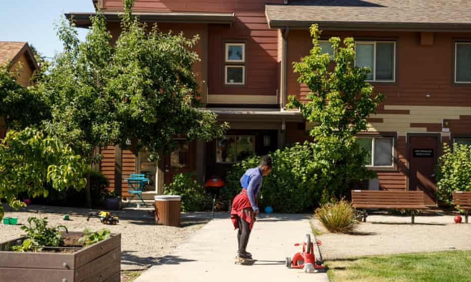 Denise, 11, skateboards outside her home in Portland.