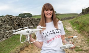 Carys Kaiser, founder of TheDroneLass pictured holding her drones.