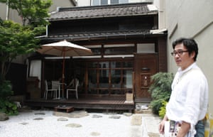 Mitsuhiro Tokuda in the backyard of a traditional home in Kitakyushu – now converted into a cafe.