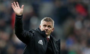 A disconsolate Ole Gunnar Solskjær waves to Manchester United's travelling fans after their 1-0 defeat at Newcastle