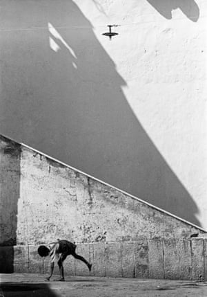 Boy playing in front of a wall, Naples, 1956