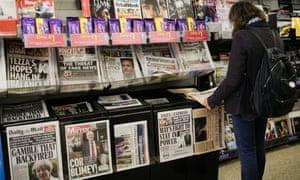 Woman looks at newspaper