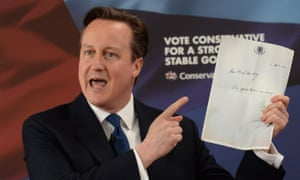 Cameron holds up the notorious note Liam Byrne left on his Treasury desk after Labour's 2010 election defeat.