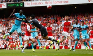 Petr Cech is left grasping thin air as Cheikhou Kouyaté rises to put West Ham United into the lead at Arsenal.