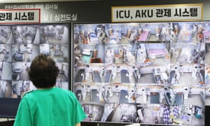A medical worker looks at a screen showing negative pressure quarantine rooms at Bagae Hospital in Pyeongtaek, 70km south of Seoul, South Korea.