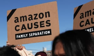 Protesters demonstrated outside of the Amazon Web Services summit on Thursday.