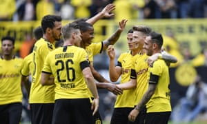 Dortmund's Marco Reus, second right, celebrates with team-mates after netting their third goal during a 5-1 Bundesliga romp against Augsburg.