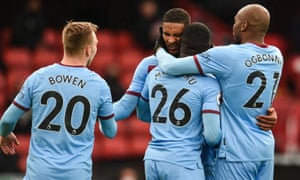 Sébastien Haller is mobbed by teammates after scoring the winner for West Ham at Bramall Lane.
