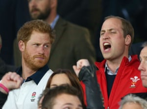 Prince Harry looks at his brother Prince William as Wales beat England at Twickenham.