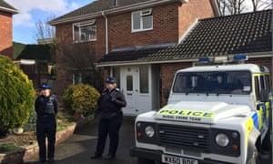 Officers outside Sergei Skripal's Salisbury home.