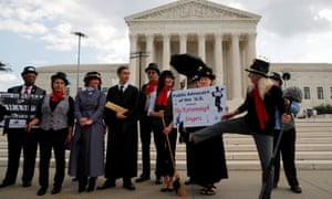 The 'Kavanaugh Singers' perform in front of the supreme court promoting the confirmation of nominee Judge Brett Kavanaugh on 8 August.