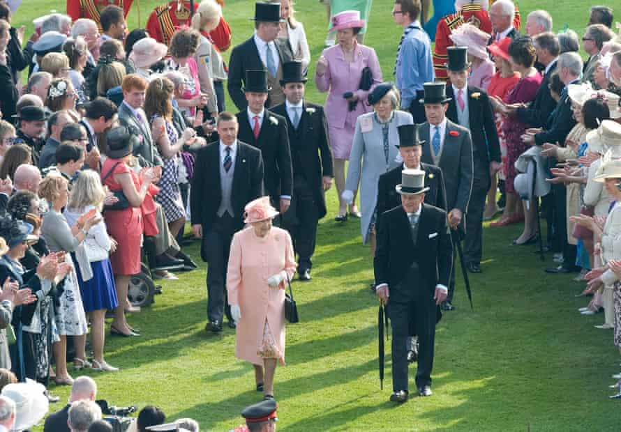 Queen Elizabeth II and Prince Philip meet guests at a Buckingham Palace garden party in 2012