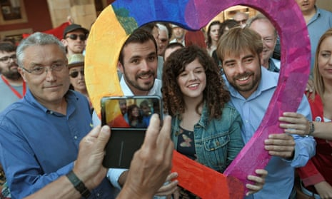 United Left leader Alberto Garzon (second left) at a rally prior to Sunday's general election. The party is running in a coalition with Podemos.