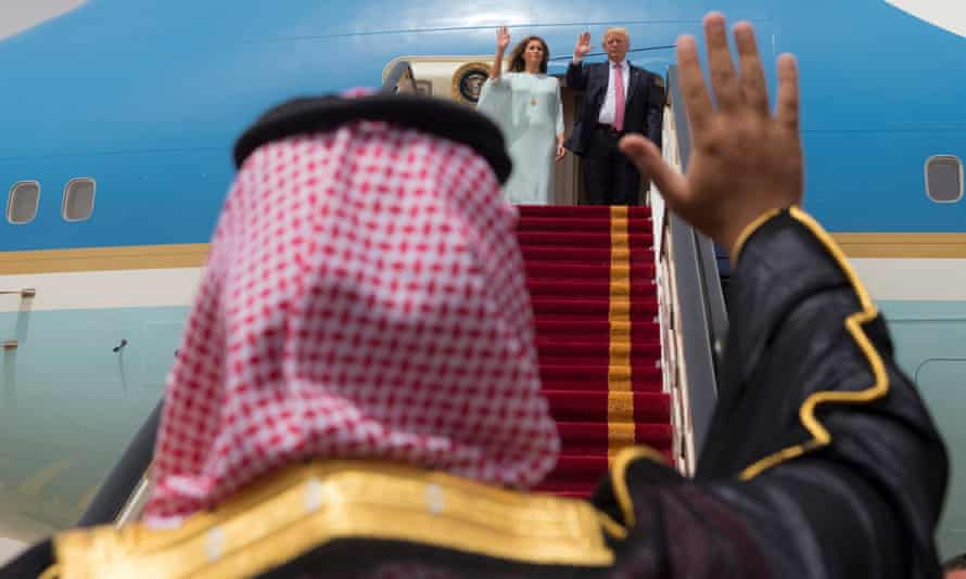 Donald Trump and his wife, Melania, wave as they board Air Force One in Riyadh
