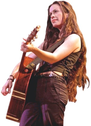 Photograph of Alanis Morissette on stage in 2001.