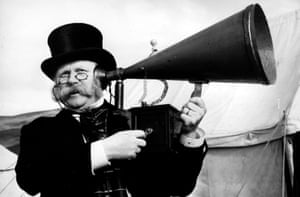 Gert Froebe in Jules Verne's Rocket to the Moon (1967) a man uses an ear trumpet, listening device