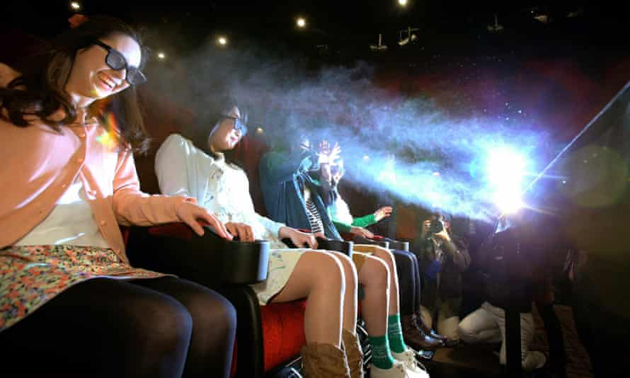 Cinemagoers get sprayed with water at a 4DX cinema in Japan.
