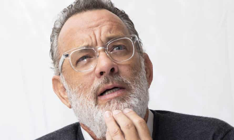 Tom Hanks with a beard, strokng his chin