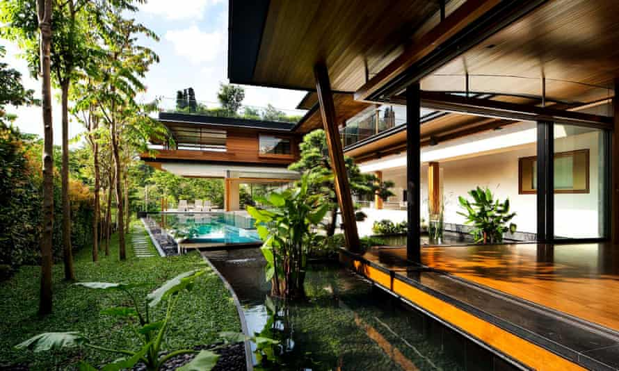 The Singapore bungalow boasts a swimming pool winding its way through the house, as well as a waterfall cascading through the property.