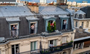 Residents living in front of the Parisian Hospital Tenon clap in support of medical staff during the lock-down ordered by the French government to combat the spread of the coronavirus on 18 April 2020 in Paris, France.