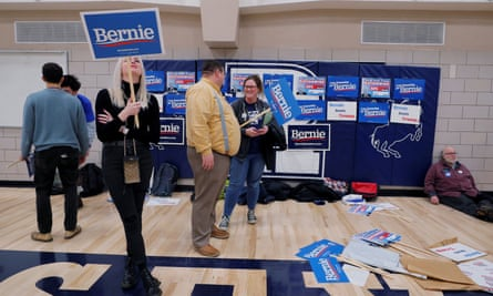 Supporters of Democratic 2020 presidential candidate Bernie Sanders wait at their caucus site in Des Moines, Iowa, on 3 February.