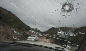 Bullet-riddled vehicles that members of the extended LeBarón family were travelling in sit parked on a dirt road near Bavispe, at the Sonora-Chihuahua state border, Mexico, on Wednesday.