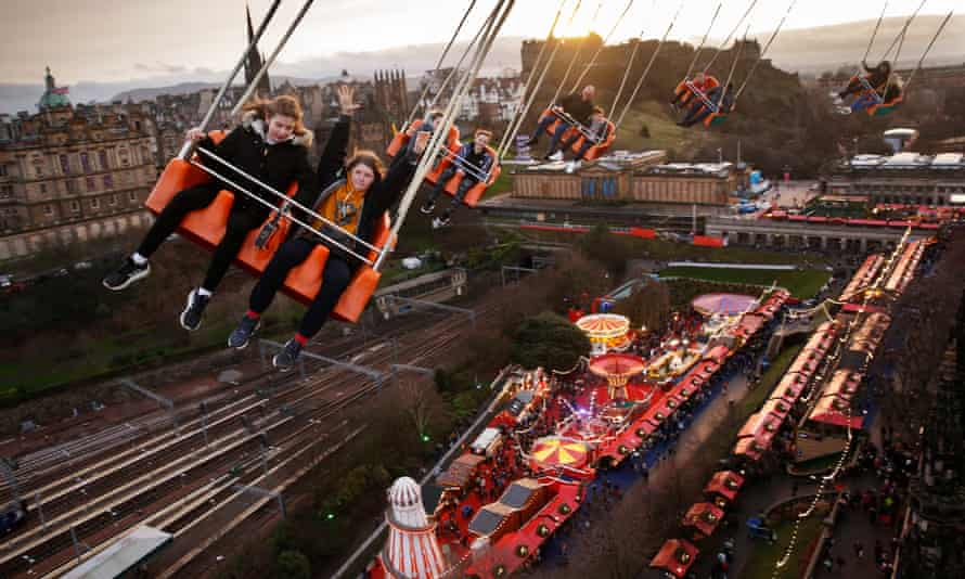 The Star Flyer lifts visitors above the Christmas market by the Mound in central Edinburgh