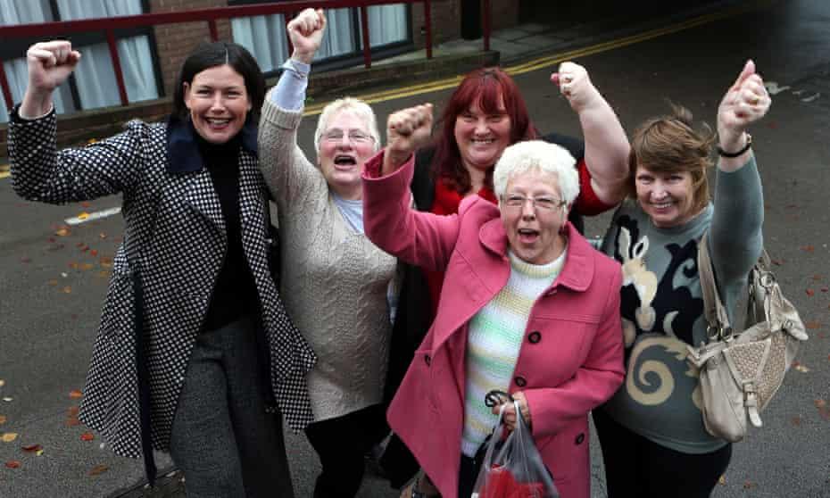 women raising fists in air