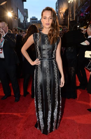 Alicia Vikander in a floor-length leather dress by Louis Vuitton.