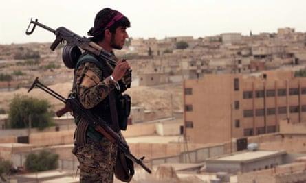 A Syria Democratic Forces fighter in Tabqa, Syria.