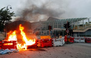 A burning barricade is pictured during a protest near a metro station.