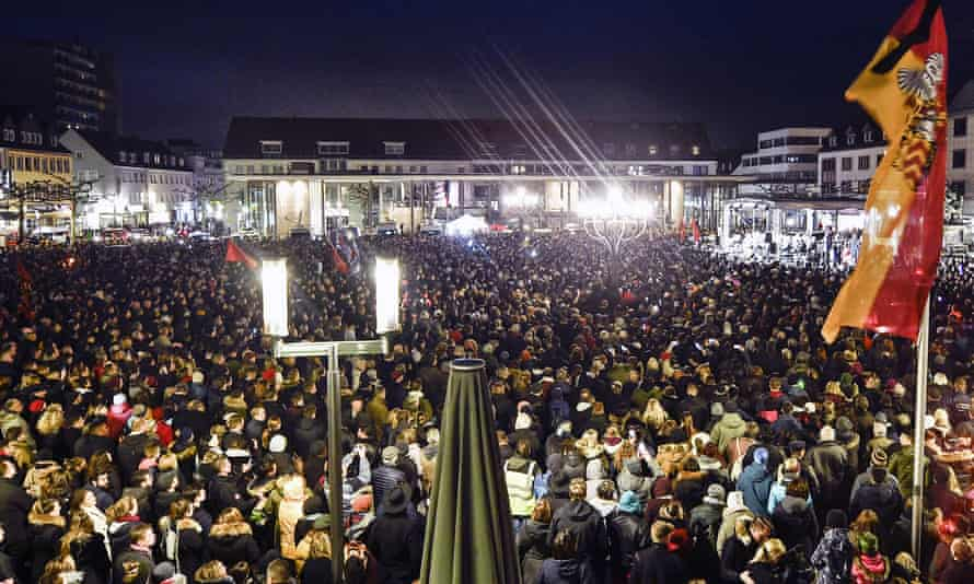 Thousands listen to German president Frank-Walter Steinmeier during a vigil in Hanau for the victims of Wednesday's shooting.