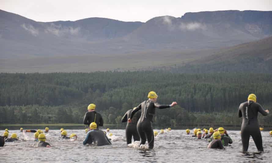 Swimmers in Loch Morlich, Scotland, UK.