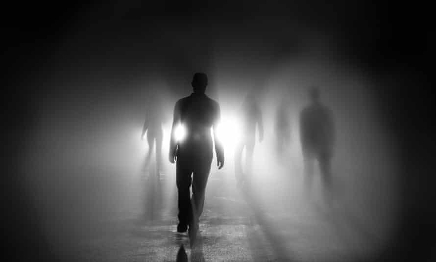 Silhouettes of people walking into lightSilhouettes of 5 people walking into light with shadows.