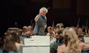 'Let's make some music' … Simon Rattle rehearses with the LSO at the Barbican.