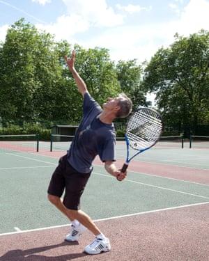 Geoff Dyer serves, Queens Park tennis courts, London