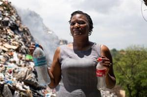 Gloria Mafole holding plastic bottles
