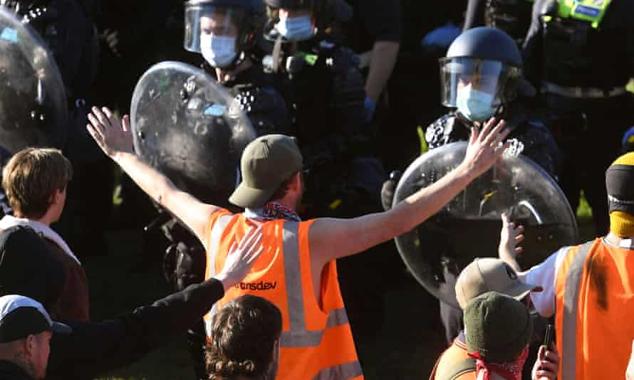 Police confront construction workers and demonstrators on the steps of the Shrine of Remembrance on one day of the violent protests.