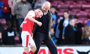Fleetwood manager Uwe Rösler celebrates with Ashley Hunter following their 2-0 victory over Scunthorpe.