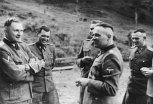 Left to right: Richard Baer, Josef Mengele, Josef Kramer, Rudolf Höss and Anton Thumann. Mengele, the Auschwitz doctor known for his horrific experiments on prisoners, was never brought to justice, while Baer escaped arrest until 1960. The other three were executed. This was taken at a July 1944 party for Höss; by that stage, the SS pictured here must have known the war was lost. It seems Höss is telling a joke – perhaps even imitating someone. A matter of days later, the SS would murder thousands of prisoners, and the killing would continue until January, when the Soviets arrived