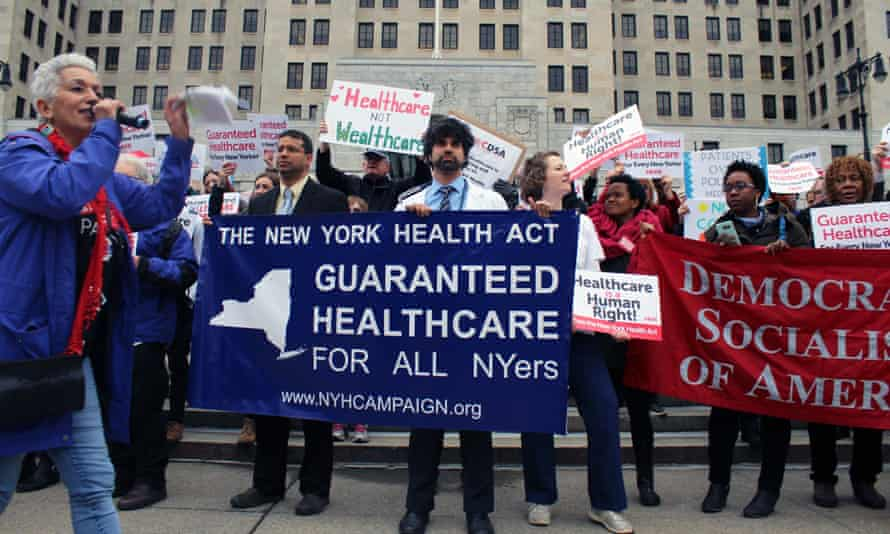 Minerva Solla (far left), an organizer with the New York State Nurses Association, works a crowd of healthcare demonstrators in Albany, New York.