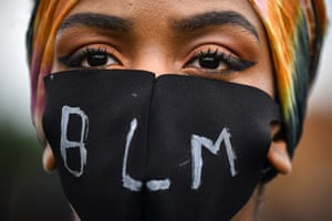 Edinburgh, Scotland A woman attends a Black Lives Matter protest in Holyrood Park