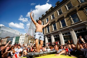 In London, one England fan climbed on top of a stationary ambulance as celebrations got out of control. .