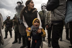 Clashes break out between refugees and anti-riot police on the island of Lesbos.