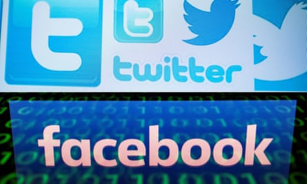 Facebook and Twitter logos on a computer screen