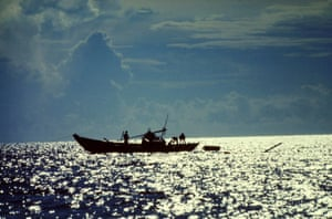 Mike Olson - Fisherman heading out in their Sampan to the South China Sea from the port in Nha Trang. Served 1969-70