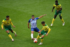 Norwich's Max Aarons battles for possession with Neal Maupay of Brighton and Hove Albion.